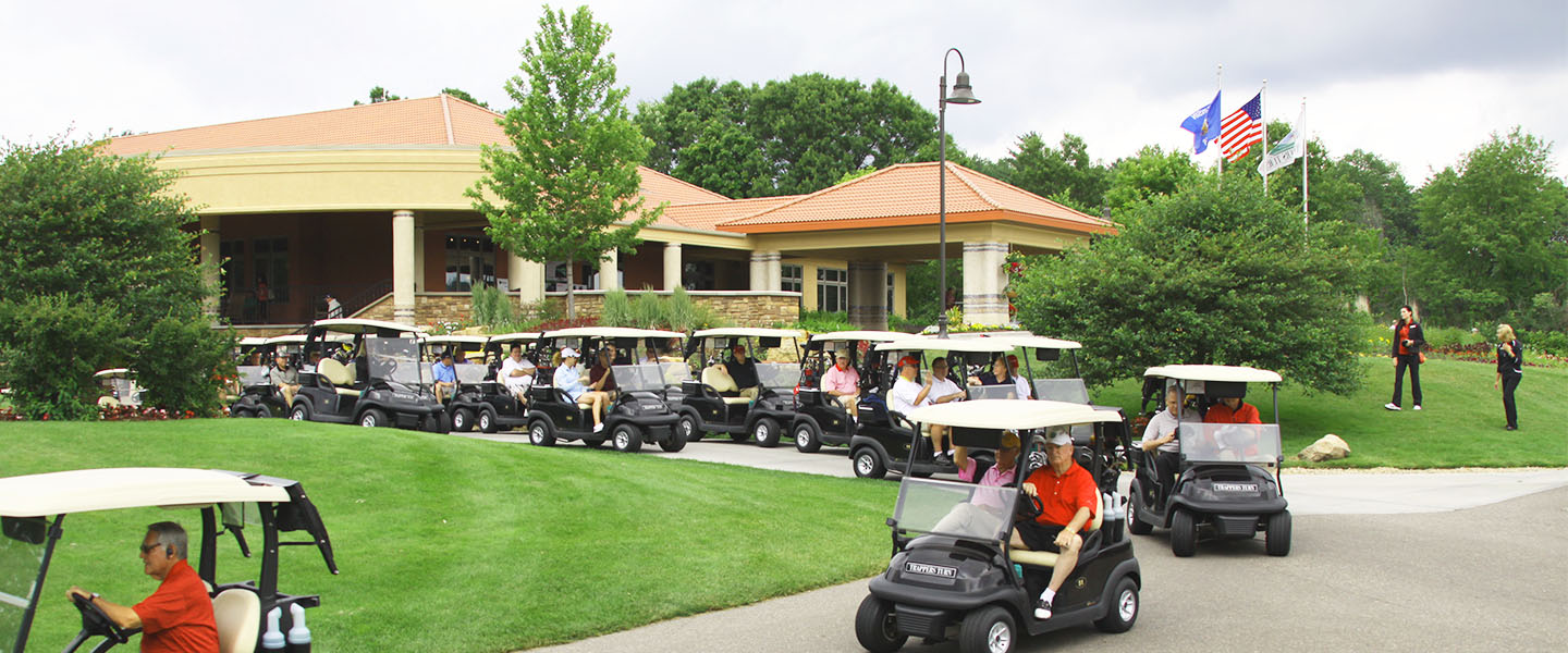 A train of golf carts with golfers heading to the course from Trappers Turn clubhouse.