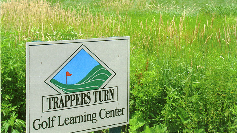 The Trappers Turn Golf Learning Center sign.